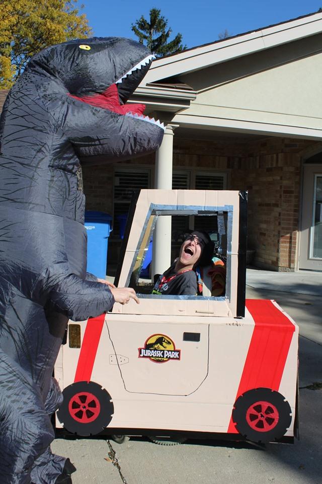Photo of a Jurassic Park recreating. Staff wearing dinosaur costume.